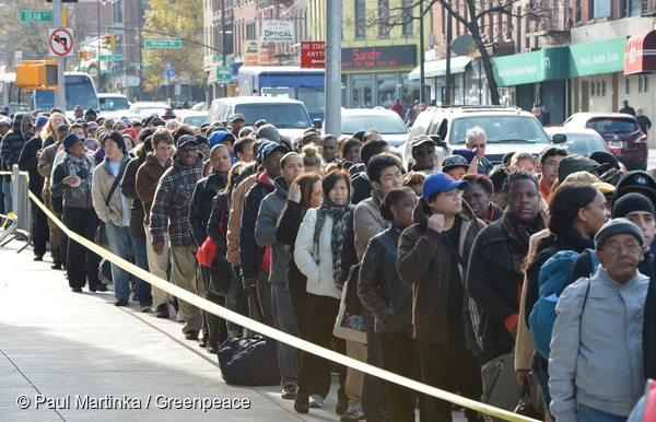 Thousands of people queue for buses in Brooklyn after Hurricane Sandy disabled subway service.