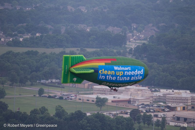 Greenpeace flies the A.E. Bates thermal airship at Walmart's world headquarters just two days before the company's coveted annual shareholders meeting. Greenpeace is asking Walmart to switch to sustainably sourced tuna and stop ocean destruction and human rights abuses of workers in the global tuna industry.