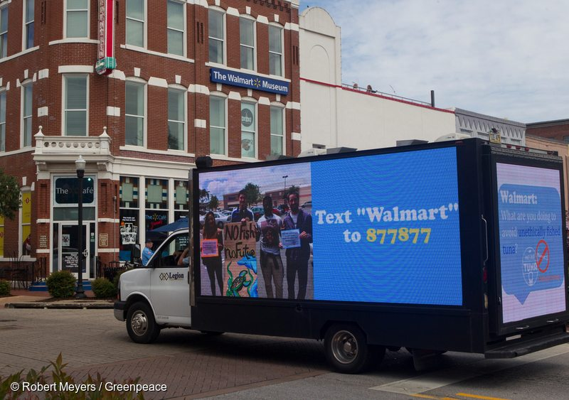 A video truck displays information about ocean destruction associated with Walmart canned tuna near their world headquarters.