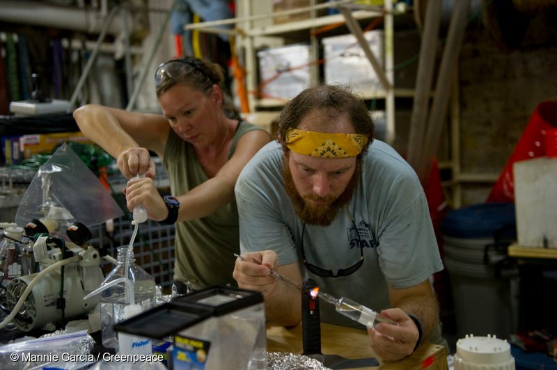 Independent scientific researchers Sally Walker, left and Clifton Nunnally, both , work in their make-shift laboratory analyizing water samples collected by the CTD unit (conductivity, temperature and depth) aboard the Greenpeace ship, MY Arctic Sunrise, in the Gulf of Mexico.