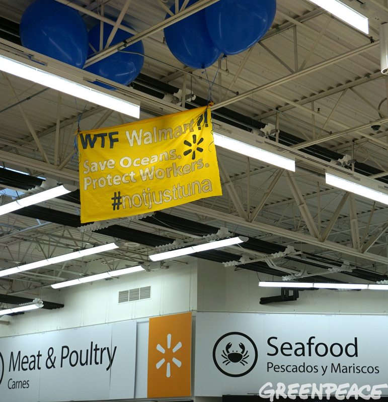 Greenpeace activists visit a Walmart store in Bentonville, Arkansas on December 7, 2016. They deployed a balloon banner and cleared some tuna cans off the shelves as a message to the company and shoppers that Walmart can do more to protect the oceans and workers. Walmart's Great Value tuna is supplied by Thai Union, the world's largest canned tuna company and the subject of numerous investigations into human rights abuses at sea. While Thai Union has taken initial steps toward ridding its supply chains of labor abuses and seeking solutions to destructive fishing, Walmart has remained silent on its role in selling the potentially tainted seafood.