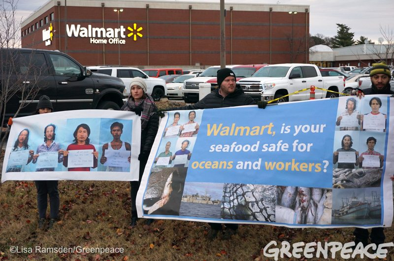 Greenpeace activists bring a message to Walmart's home office front door on ocean destruction and labor abuse in Bentonville, Arkansas on December 6, 2016. Walmart's Great Value tuna is supplied by Thai Union, the world's largest canned tuna company and the subject of numerous investigations into human rights abuses at sea. While Thai Union has taken initial steps toward ridding its supply chains of labor abuses and seeking solutions to destructive fishing, Walmart has remained silent on its role in selling the potentially tainted seafood. Photo by Tazz