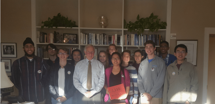 Students with my organization, Duke Climate Coalition, meet with Duke University's President to deliver nearly 1,200 petition signatures calling for the university to end the plant proposal