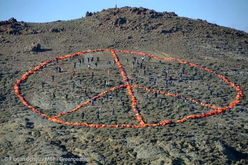 On New Years Day 2016, a Médecins Sans Frontières/Doctors without Borders (MSF)-Greenpeace team on the Greek island of Lesbos were joined by groups such as Sea-Watch, the Dutch Refugee Boat Foundation and local communities, to create a peace sign formed from over 3,000 discarded refugee life jackets. The groups are called for safe passage to those fleeing war, poverty and oppression.