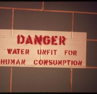 Sign in a restroom along Interstate 25 south of Colorado Springs, Colorado, warns that water is undrinkable, April 1974