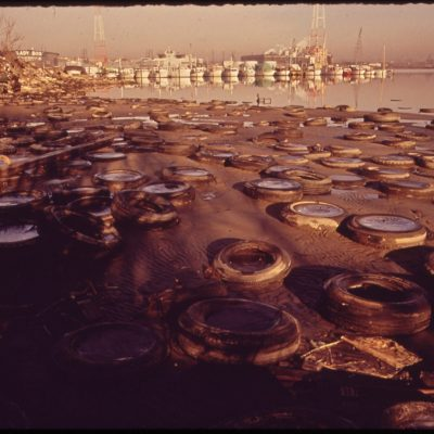 Trash and Old Tires Litter the Shore at the Middle Branch of Baltimore Harbor, January 1973