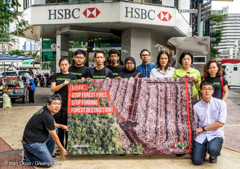 Greenpeace activists carry a banner as they deliver a petition to HSBC Headquarter in Kuala Lumpur. More than 220,000 people globally signed the petition urging HSBC to stop funding six palm oil corporations that destroy the rainforest and peat land in Indonesia.