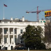 "Greenpeace activists deploy a banner on a construction crane near the White House reading ""RESIST"" on President Trump's fifth day in office. The activists were calling for those who want to resist Trump's attacks on environmental, social, economic and educational justice to contribute to a better America."