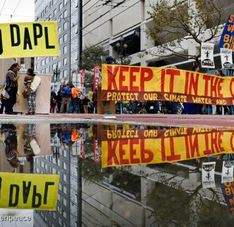 People carry signs in support of the Standing Rock Nation at the City Center Plaza of San Francisco. The protest was one of many in a global day of action against the Dakota Access Pipeline (DAPL) calling on the U.S. Army Corps of Engineers to cancel the permit for the project.