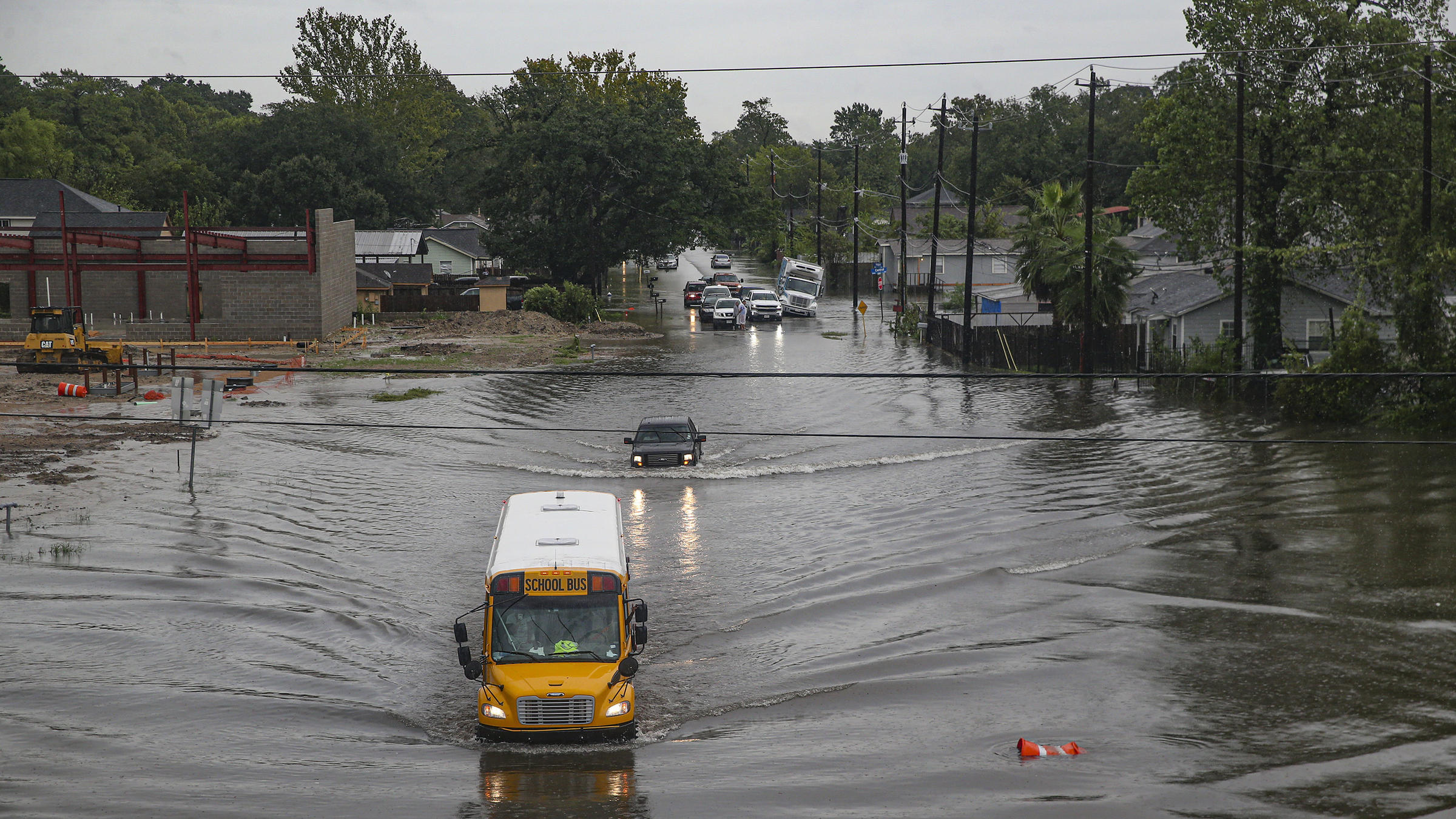 A school bus makes its way through a flooded road in Houston