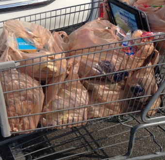 Shopping cart with plastic-bagged items