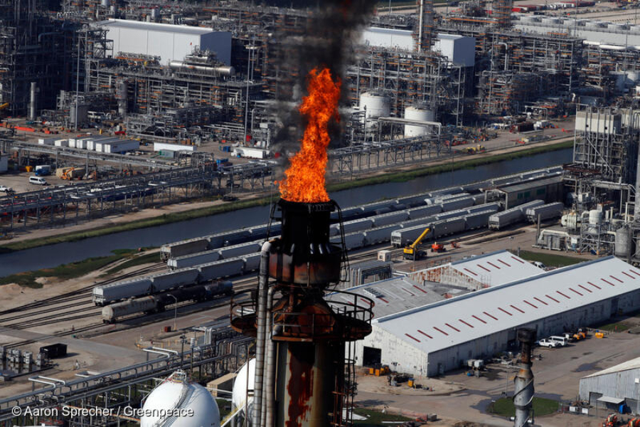 An industrial flare burns off waste at refining plant more than a week after Hurricane Harvey hit the Texas area