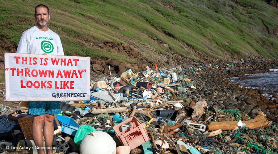 Greenpeace Ocean Director John Hocevar near plastic trash piles.