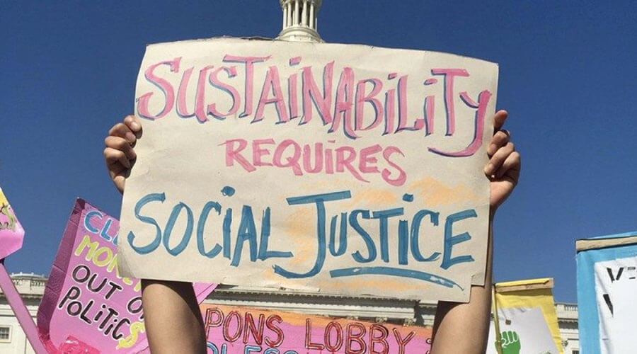 "Sign that says ""Sustainability Requires Social Justice"""