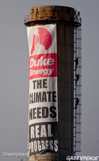 Greenpeace activists protesting the destruction and pollution caused by coal at the Progress Asheville Power Station hang with a banner at the plant February 13, 2012. Activists have secured themselves to the coal loader and conveyers, which will prevent coal from entering the facility.  The Progress Energy owned Asheville Power Station uses the most destructive form of coal mining, mountain top removal, which is flattening mountains across Appalachia. The plant produces 1,994 pounds of sulfur dioxide, 788 pounds of nitrogen oxides, and 2,629,243 tons of carbon dioxide. Its coal ash ponds are designated 'high hazard' by the EPA, meaning they are likely to kill people if they spill.  Photo by Les Stone/Greenpeace  #occupyduke
